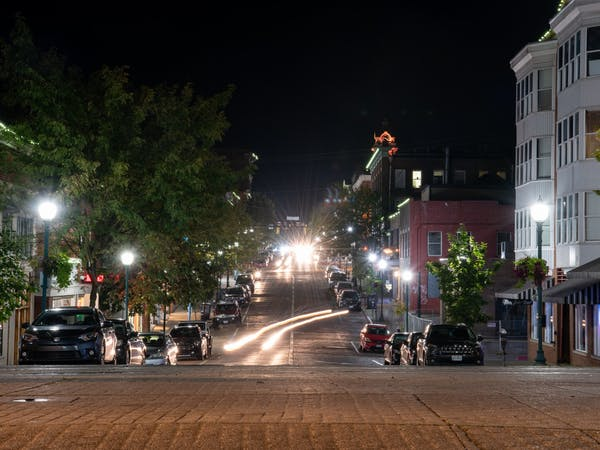 (FILE) Cars drive down Court Street in Athens, Ohio, on Tuesday, Aug. 25, 2020.