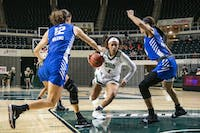 Ohio's Cece Hooks (#1) drives to the basket between two Buffalo defenders, Courtney Wilkins (#12) and Summer Hemphill (#0), during two teams' game on Feb. 27. (FILE)