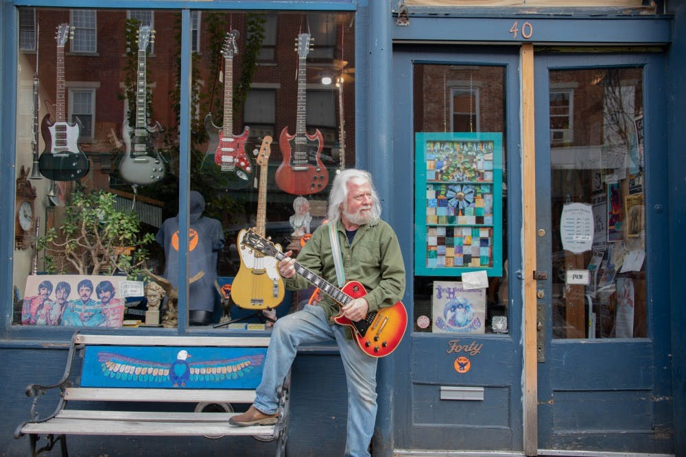 Local music store owner showcases extensive guitar collection