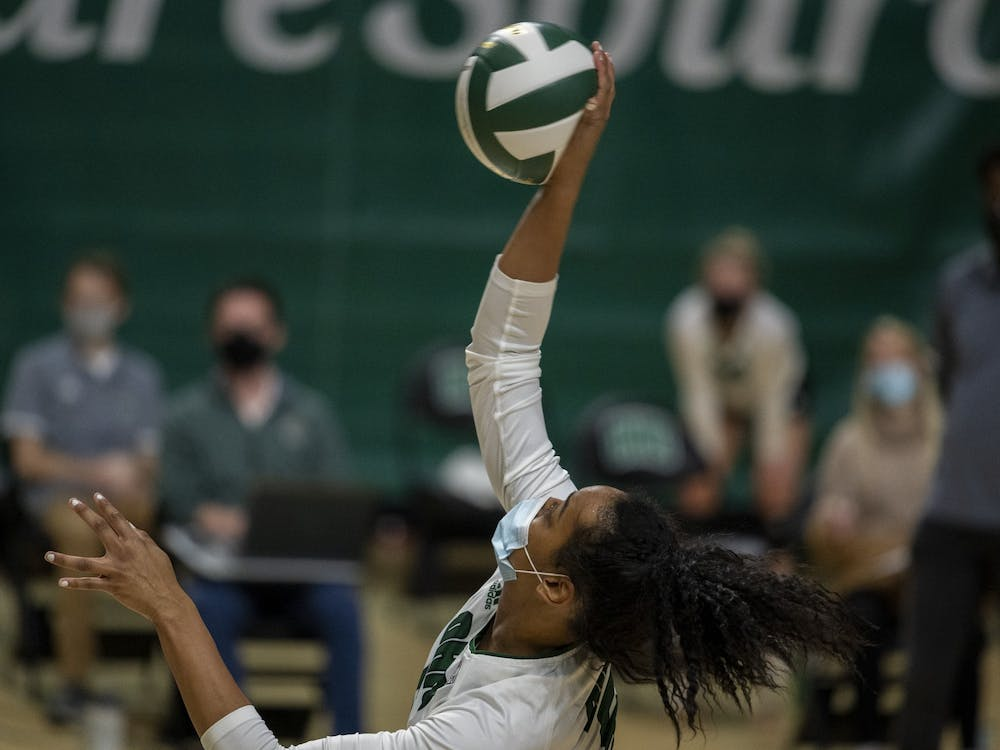 Ohio University outside hitter, Mariana Rodrigues (5), hits the ball during the home match against Central Michigan University. (FILE)