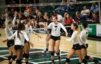 Ohio's Katie Nelson celebrates with her teammates during the match against Virginia Tech on Sept. 7. (FILE)