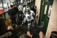 Ohio forward Bryan Lubin (no. 10) greets fans after an overtime win against Illinois on Saturday, December 8.