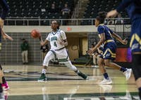Erica Johnson (#4) passes the ball while being defended by Shaunay Edmonds (#3).