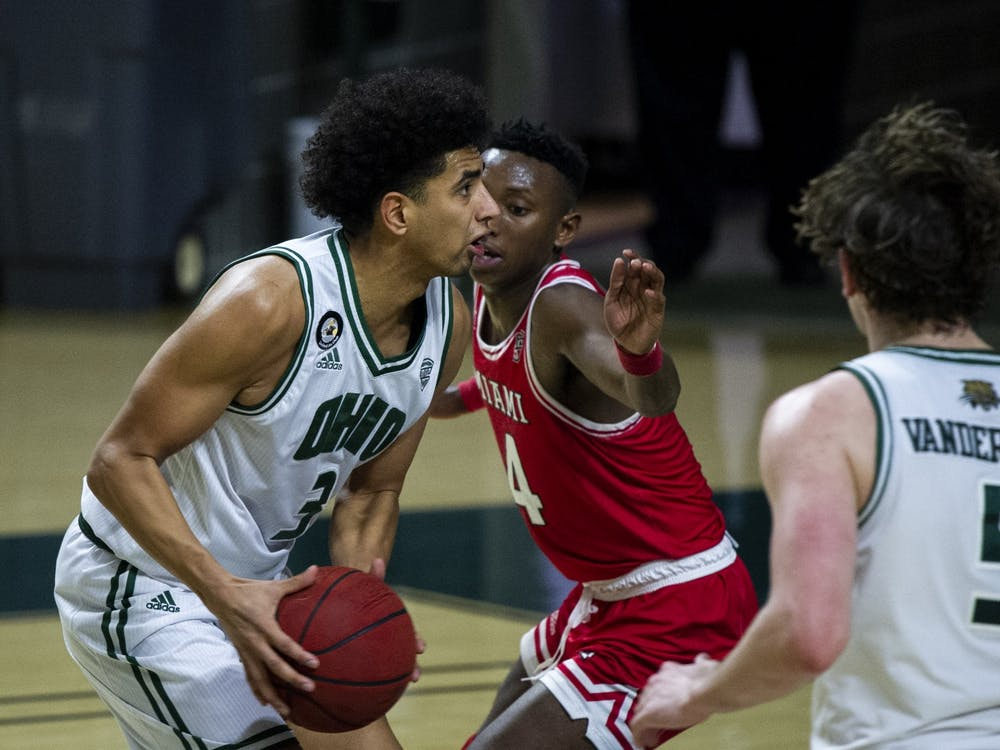 Ohio University's, Ben Roderick (3) looks to take the ball to the basket while being guarded by Miami University's, Isaiah Coleman-Lands (4) during the home game on Tuesday, Jan. 12, 2021, in Athens, Ohio.