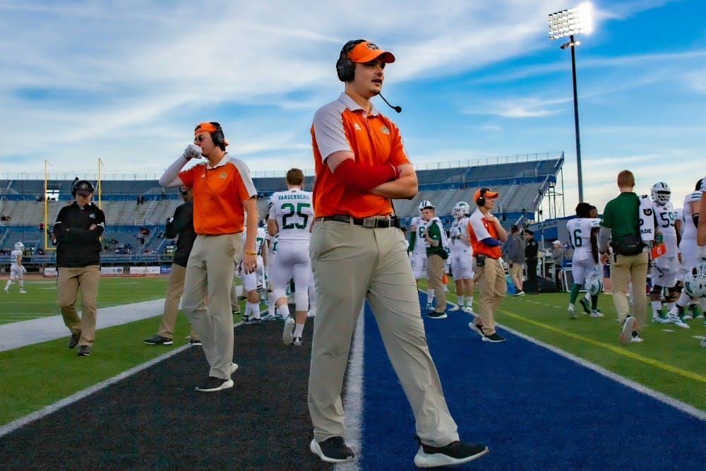 'It's pretty much a game of charades': Meet the student assistants who act out each play call for Ohio's offense