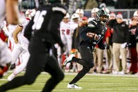 Ohio cornerback Jalen Fox (#21) returns an interception in the first half of the Bobcats' game against Miami on October 31. (FILE)