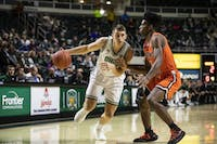 Ohio forward Jason Carter drives to the hoop in the first half of the Bobcats' game against Campbell on Monday.