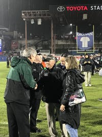 Frank and Pamela Solich talk with Ohio athletic director Jim Schaus.