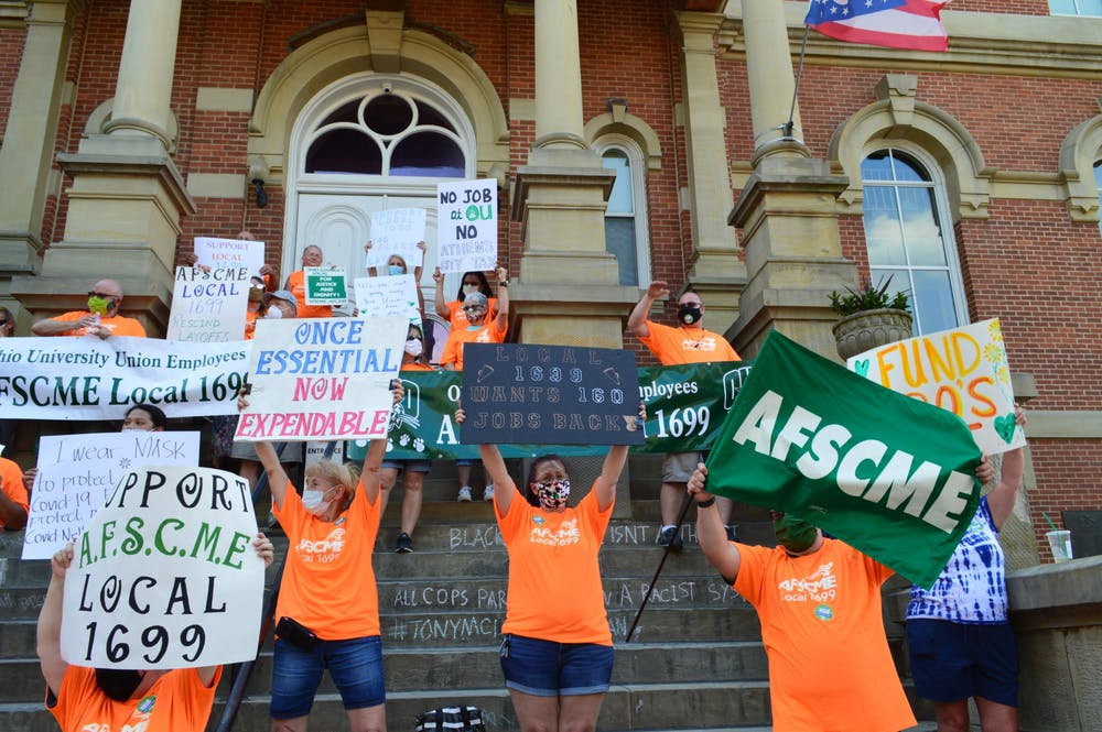 Classified employees, union supporters march against recent university layoffs