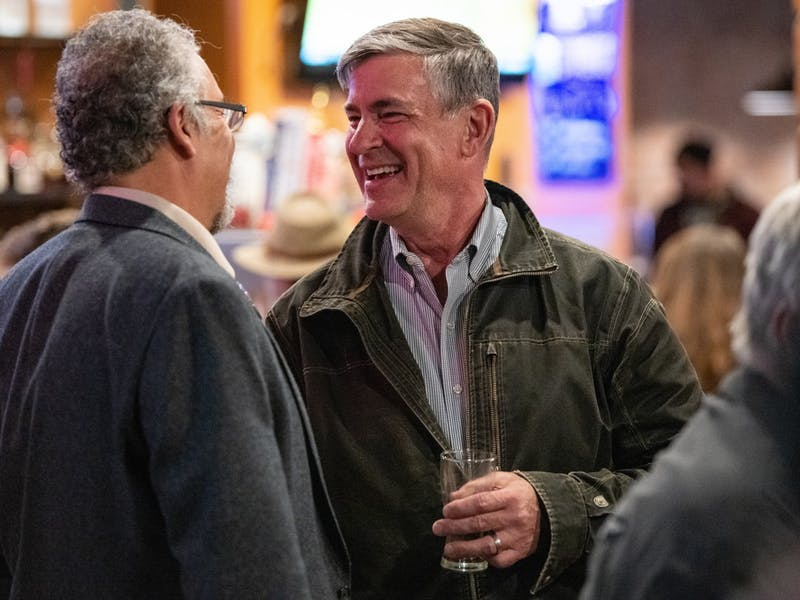 Ric Wasserman (left) talks to Steve Patterson (right) at The Pigskin Bar and Grille on Tuesday, November 5, 2019. Patterson won reelection as the Athens mayor during the 2019 elections.