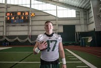 Austin Conrad, a Defensive lineman, poses for a portrait in Walter Field house on Wednesday, April 10, 2019.