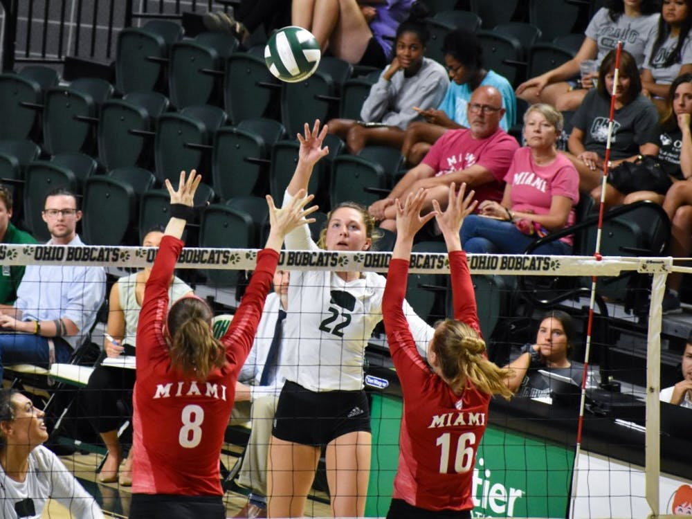 Ohio's Olivia Margolies (No. 22) tips the ball over Miami University blockers during the match against Miami on Sept. 28, 2019.