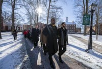 Members of Alpha Phi Alpha, a historically black fraternity at Ohio University, lead a silent march through College Green in honor of Martin Luther King Jr on January 21, 2019.