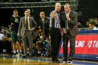 Ohio coach Saul Phillips gets an explanation about a foul call from the referee in the first half of the Bobcats' 108-82 loss to Buffalo on Saturday.