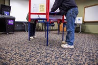 Dick Planisek (right) and his wife Lana fill out ballots at a polling center located at the Innovation Center on State St. for Election Day  in Athens, Ohio, on Tuesday, Nov. 5, 2019.