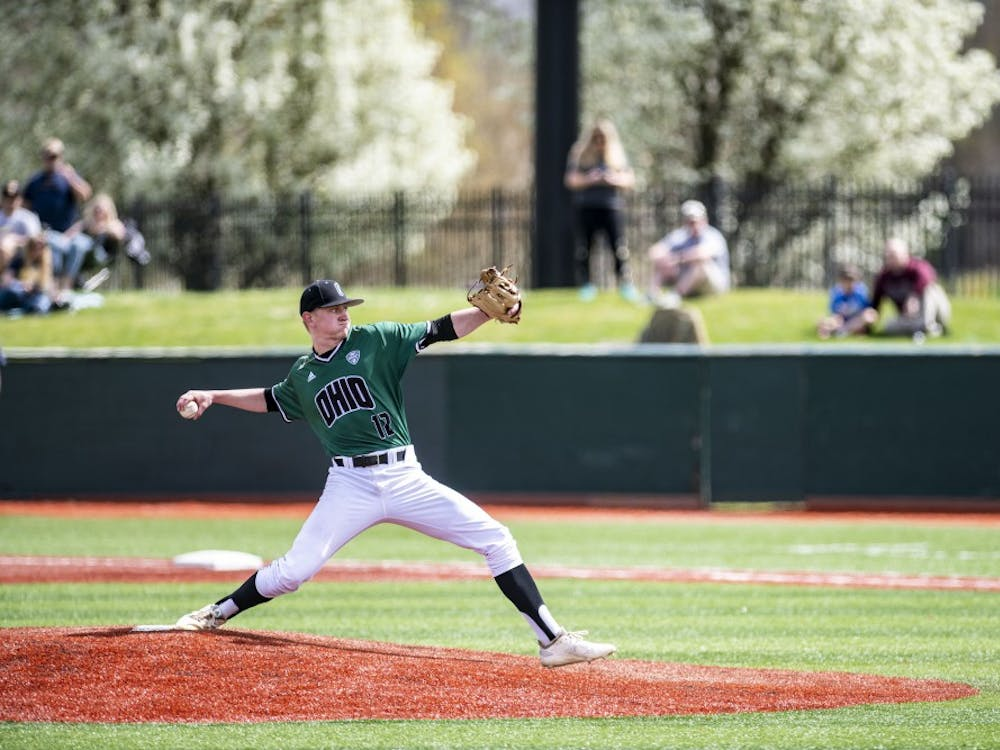 Ohio's, Jack Liberatore (#12), pitches during the Bobcats' game against the University of Toledo on April 13. The Bobcats beat the Rockets 5-2 in their first game of the doubleheader.
