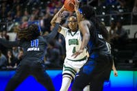 Ohio's Erica Johnson (#4) looks to pass with pressure from Buffalo's Theresa Onwuka (#11) during the home game on Saturday, Feb. 29, 2020.