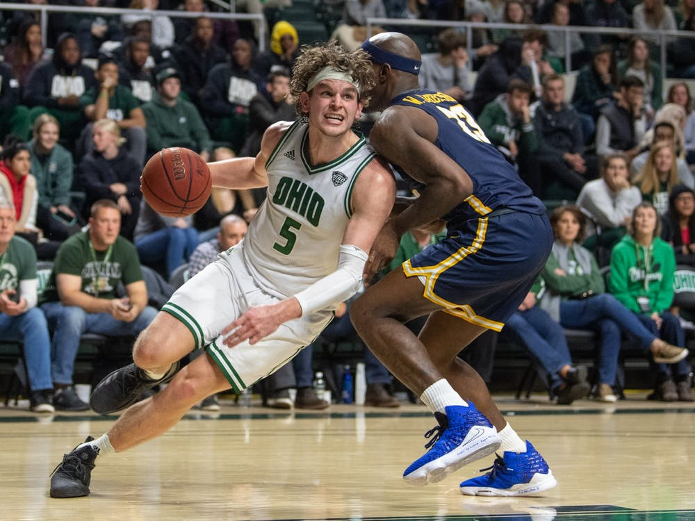 Ohio's Ben Vander Plas drives past Toledo's Willie Jackson during their game on Tuesday, Jan. 21, 2020, in The Convocation Center. Ohio lost the game 83-74.