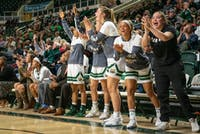 The Ohio Bobcats celebrate a 3-pointer during their game against Marshall on Wednesday, Nov. 13, 2019.