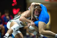 Cameron Kelly wrestles with American University's Esteban Gomez-Rivera (BLAKE NISSEN | FOR THE POST)