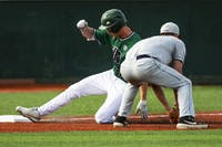 Ohio infielder Aaron Levy (#33) slides into third base during the Bobcats' game against Toledo on Saturday, April 13. (FILE)