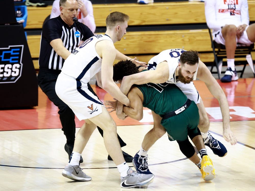 BLOOMINGTON, IN - MARCH 20: The Virginia Cavaliers take on the Ohio Bobcats in the first round of the 2021 NCAA Division I Men