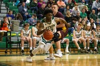 Athens Bulldogs point guard Elijah Williams (no. 3) moves past Meigs guard Coulter Cleland (no. 10) during the second half of the Bulldogs game against Meigs High School on Feb 8. The Bulldogs won 55-51.
