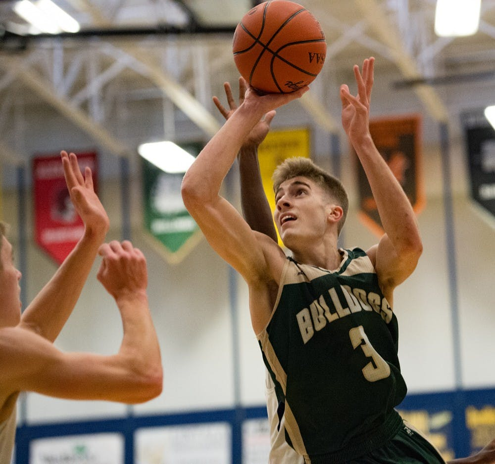 Athens Basketball: Lutz, Cozart fuel Bulldogs' thrilling playoff victory over Sheridan