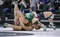 Ohio's Zac Carson wrestles with Central Michigan's Logan Parks on Jan. 31, 2020, in The Convo.