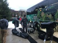 Scott Bagby helps unload the team bus at LaHaye Ice Center on Nov. 9.