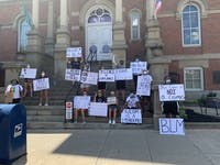 Bobcats Lead Change, a group of Ohio University student athletes, protested against police brutality and racial oppression in front of the Athens County Municipal Court on Wednesday, July 1, 2020.
