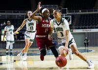 Ohio's Amani Burke (#3) drives towards the basket against Miami's Lauren Dickerson (#13) during their game on Jan. 30, 2019. (FILE)