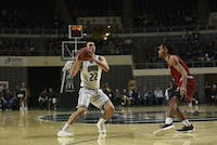 Ohio's Gavin Block (#22) looks for a pass during its game against Miami on Friday at the Convo.