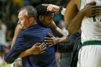 Ohio head coach Saul Phillips and senior guard Mike Laster embrace after Laster was subbed off for the last time in his Ohio career at The Convo. Laster was the first player that Phillips recruited as head coach back in 2014.