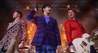 The Jonas Brothers Happiness Begins tour reintroduces audiences to the power of brotherhood and music. (Photo via @Variety on Twitter)