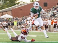 Ohio junior Quinton Maxwell scores a touchdown during the Bobcats' game against Bowling Green on Oct. 20. (FILE)
