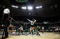 Senior Jaime Kosiorek goes up to spike the ball while playing Samford University in the first game of the Bobcat Invitational. (FILE)