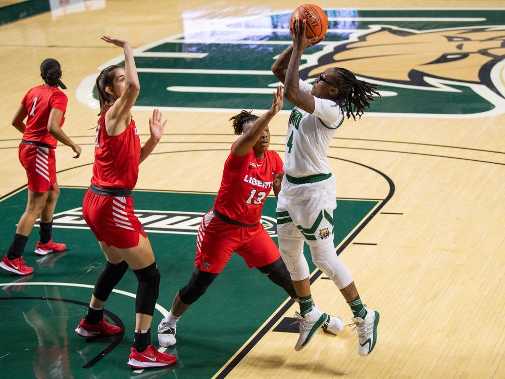 Ohio's guard Erica Johnson (No. 4) takes a shot against Liberty in a game held at The Convo on Wednesday, Nov. 25, 2020.