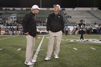 Ohio Bobcats coach Frank Solich and asst. Coach Jimmy Burrow (Calvin Mattheis | Ohio Athletics)