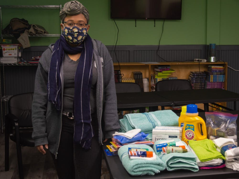 Sojourner's Resiliency Center Program Director Eryn Powell stands beside personal necessities for those in need on Tuesday, Feb. 16, 2021.