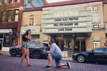 Ohio University graduates Ryan Schulman and Carly Finton got engaged underneath the Athena Cinema marquee. (via @r_Schulman on Twitter)