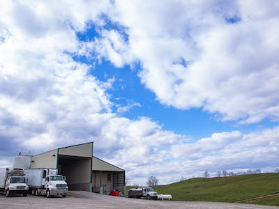 Snowville Creamery, the organic dairy supplier in Pomeroy, Ohio, is nestled between its hills dividing the main plant from the farmland.