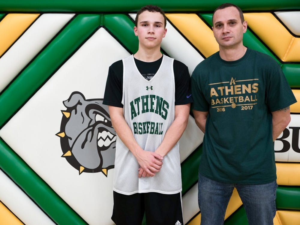 Athens Highschool Basketball Coach Mickey Cozart, left, poses for a portrait with his son, Dalton Cozart, at Athens High School on February 21.