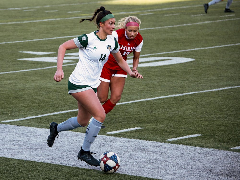 Ella Bianco (#14) drives the ball down the sideline during the Ohio University home game at Peden Stadium in Athens, Ohio, on March 4, 2021. The Bobcats lost to the Redhawks 0-1. (FILE)