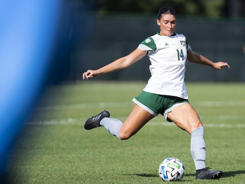 Ohio's Ella Bianco (#14) kicks the ball during the Ohio versus Northern Kentucy match at Chessa Field on Thursday, Sep. 9, 2021. Ohio lost 1-0.