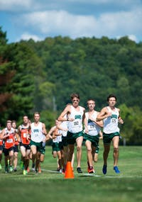Ohio University senior Kurt Steinmuller, left, and senior Andrew Miller, right, lead the pack during their home cross country meet at the Ohio University golf course on Friday, Sept. 5, 2014.