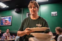 Veteran Union Street Diner waitress Jodi Webster serves customers on Wednesday.