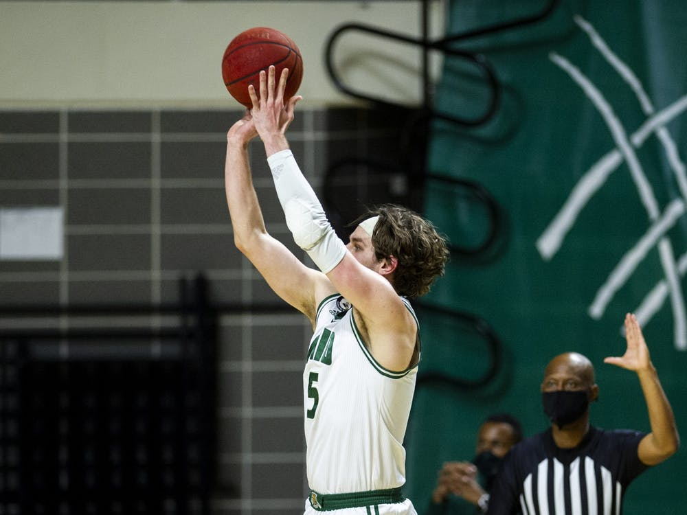 Ohio University's Ben Vander Plas (5) sinks a three pointer during the home game against Eastern Michigan University on Thursday, Feb. 25, 2021 in Athens, Ohio.