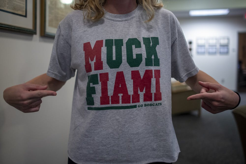 "Uptown Dog to sell new shirt designs after receiving cease and desist from licensor for ""Muck Fiami"" shirts"