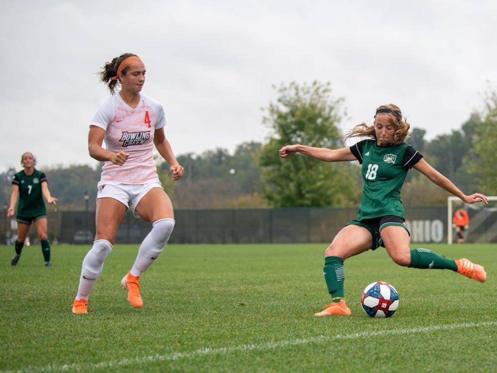 Ohio University defender Sydney Leckie prepares to kick the ball past Bowling Green's Kennedy White during the game at Chessa Field on Sunday, October 6, 2019. Ohio lost the match 3-1.